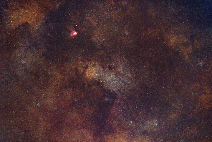 Swan Nebula and Small Saggitarius Star Cloud photographed with Rokinon/Samyang 135mm f/2 lens.